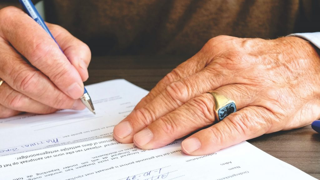 person signing an IOU