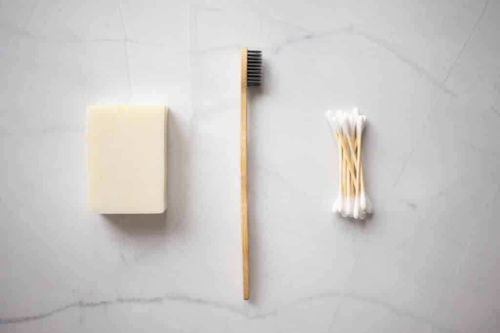 toothbrush with solid toothpaste and cotton swab